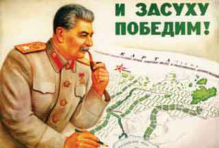 "Stalin working on his Great Plan for the Transformation of Nature. The poster reads ""And We Shall Conquer Drought""."